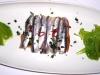 Alicette marinate del Mediterraneo con crostini ai capperi di Serraghia