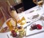 Variazione di dolci del Convivio con fior di panna all'arancia e cialda al pistacchio, cheesecake, tortino di cioccolato caldo con cuore liquido e fragole